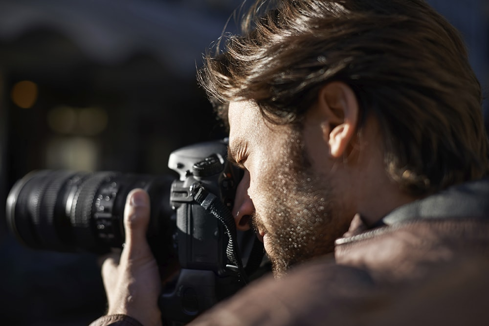 Professional photography is all about eyesight - considering LASIK for photographers while looking through viewfinder to get the perfect shot