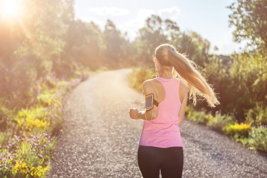 woman running with healthy vision