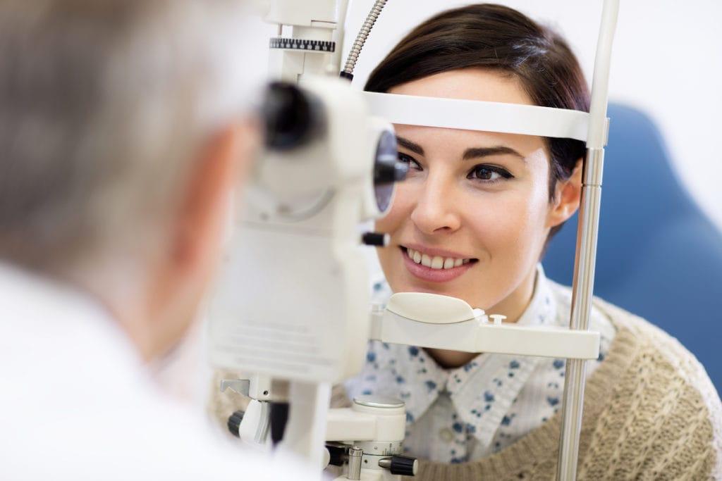 a woman getting a comprehensive annual eye exam